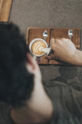 Man preparing milk coffee - OCAF00326