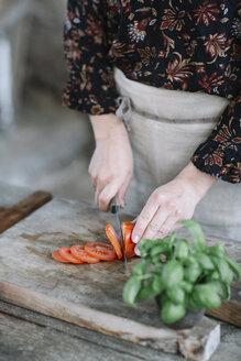 Woman preparing Caprese Salad, partial view - ALBF00518
