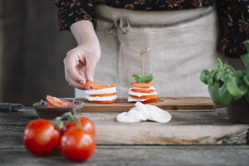 Woman's hands preparing Caprese Salad - ALBF00524