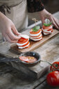 Woman preparing Caprese Salad, partial view - ALBF00530
