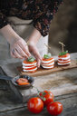 Woman preparing Caprese Salad, partial view - ALBF00533