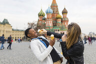 Russia, Moscow, multiracial couple eating icecream - WPEF00428