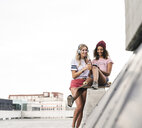 Best friends with skateboard, having fun together, listening music - UUF14257