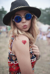 Portrait of hipster woman at the music festival - ABIF00603