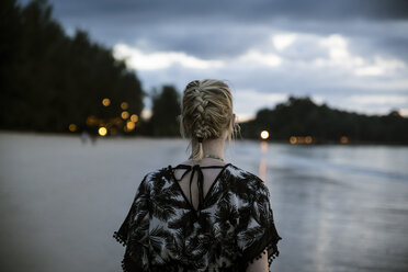 Thailand, Khao Lak, back view of woman on the beach at evening - CHPF00478