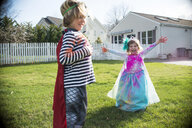 Children in costumes playing outdoors - ISF12705