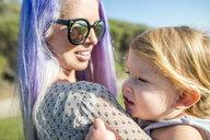 Mother and baby enjoying sun, El Capitan, California, USA - ISF12708