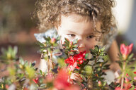 Young girl, smelling flowers, outdoors - ISF12873