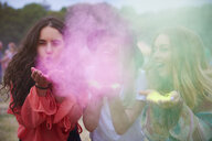 Portrait of friends at music festival, colour powder - ABIF00614