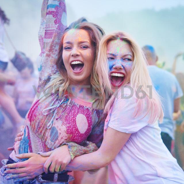 Friends dancing together at music festival - ABIF00632