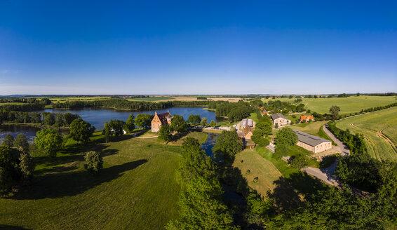 Germany, Mecklenburg-Western Pomerania, Mecklenburg Lake District, Schwinkendorf, Aerial view of Ulrichshuser See and Ulrichshusen Castle - AMF05747