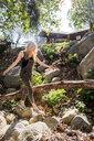 Woman walking on rocks, El Capitan, California, USA - ISF13235
