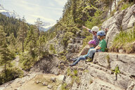 Father and children enjoying view on hill, Ehrwald, Tyrol, Austria - ISF13730