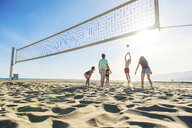 Group of friends playing volleyball on beach - ISF13886