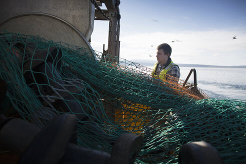 Fisherman preparing net, Isle of Skye, Scotland - ISF14099