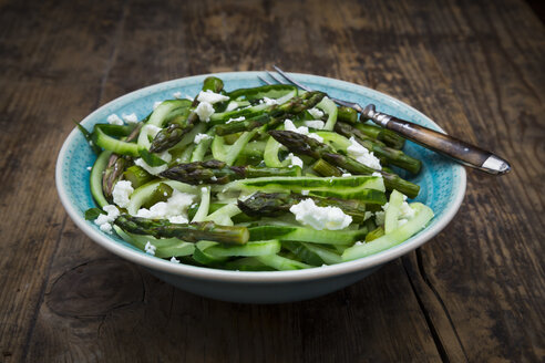 Bowl of green asparagus salad with helically coiled cucumber and feta cheese - LVF07122