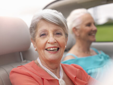 Two senior women driving in convertible - CUF33235