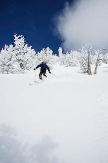 Young man skiing downhill at Lake Tahoe, California, USA - CUF33262