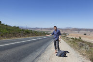 Hitchhiker on side of road - CUF33304