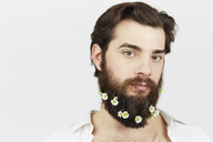 Portrait of man with flowers in beard - ISF14162