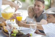 Family dining outdoors - CUF33507