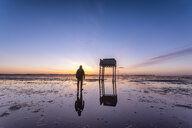 United Kingdom, England, Northumberland, posts marking the pilgrims' way crossing to Lindisfarne with emergency refuge, sunrise - SMAF01044