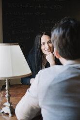 Elegant couple talking in a cafe - ALBF00546