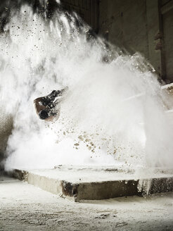 Man jumping in flour dust cloud during freerunning exercise - CVF00853