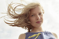 Portrait of girl with flyaway hair at breezy coast - CUF33713