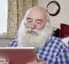 Senior man using digital tablet - CUF33773