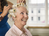 Senior woman with rollers at hairdressers - CUF33815