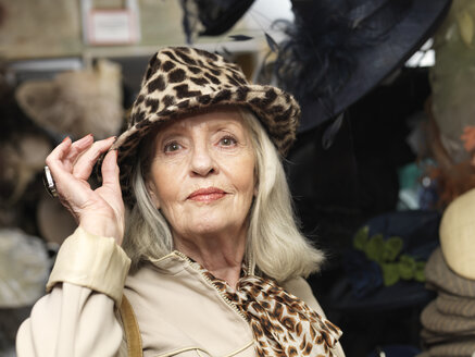 Glamorous senior woman in leopardskin hat - CUF33818