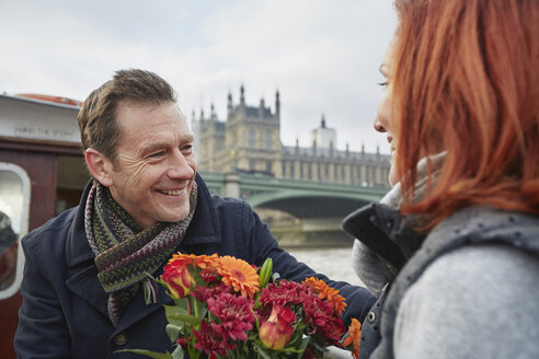 Romantic mature couple with bunch of flowers, London, UK - CUF33939
