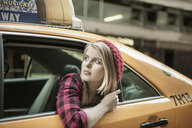 Young woman looking out from yellow cab, New York City, USA - CUF33957