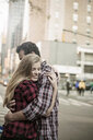 Young couple hugging on street, New York City, USA - CUF33966