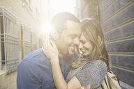 Tourist couple hugging, Valencia, Spain - CUF33999