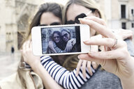 Two young female friends taking a self portrait, Valencia, Spain - CUF34005