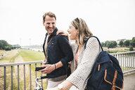 Happy couple crossing a bridge - UUF14301