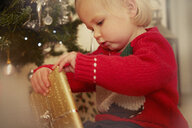 Baby girl with Christmas present - CUF34399