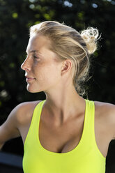 Close up of young woman in crop top - CUF34426