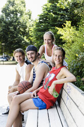 Portrait of four basketball players taking a break in park - CUF34441