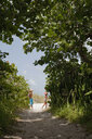Boy and his sister playing on woodland beach path, Anna Maria Island, Florida, USA - ISF14384