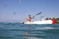 Kayaker rowing in sea - ISF14399