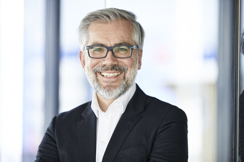 Portrait of smiling businessman - RBF06352