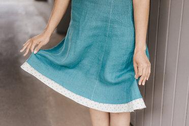 Hands holding lap of skirt - KNSF04079