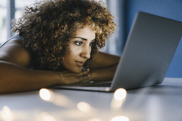 Woman working overtime in her start-up business - KNSF04184