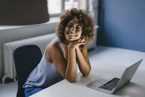 Woman working overtime in her start-up business - KNSF04187