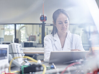 Female technician working in research laboratory, drawing  with stylus on tablet - CVF00874