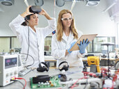 Female technicians working with tablet and vr glasses - CVF00877