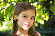 Little girl with cherries on ears - LVF07143